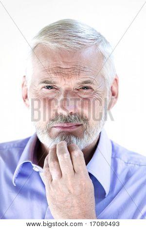 caucasian senior man portrait pensive suspicion isolated studio on white background