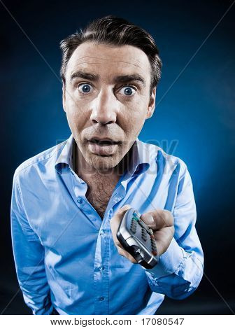 caucasian man switch channel stun portrait isolated studio on black background