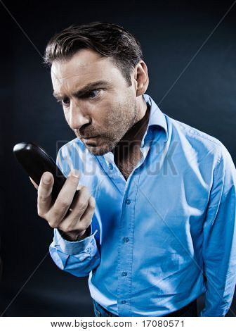 caucasian man angry phone malfunction unshaven portrait isolated studio on black background