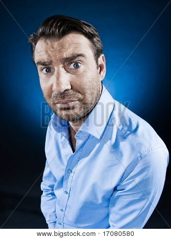 caucasian man frown sulk unshaven portrait isolated studio on black background