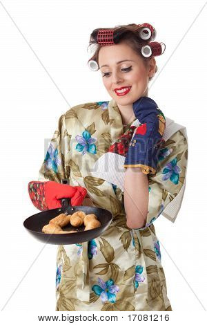 Young Housewife With Cookies In Frying Pan