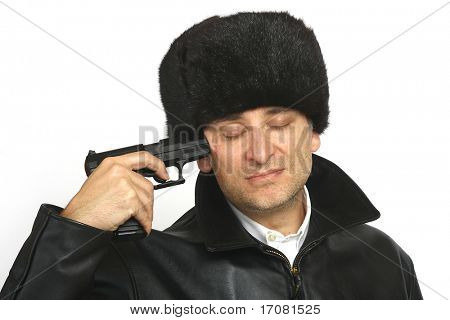 A man in Russian clothing complete with a 9mm automatic handgun pointed at his own head