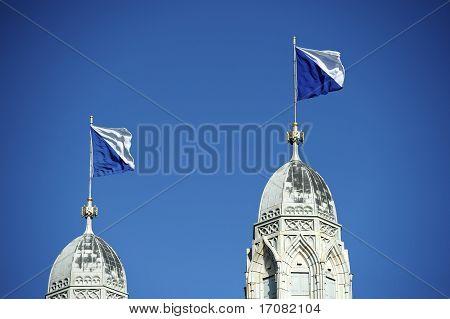 Flagged Steeple Of Grossmunster, Zurich