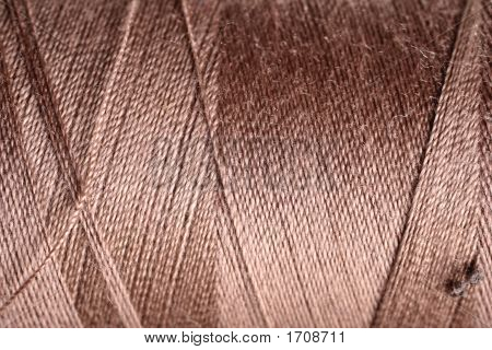 Brown Thread Fabric Wool Yarn Wrapped In A Spool Of Threads And Textiles Great For A Background