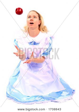 Young Attractive Beautiful And Shocked Woman Or Girl In Blue Dress Catching A Falling Apple In Excit
