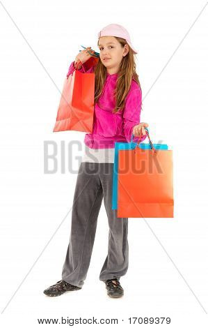 Funky young girl with shopping bags isolated on white background
