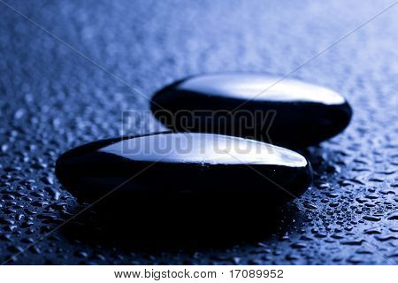 shiny spa stones with water drops