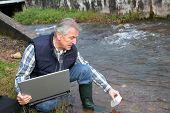 Hydro-biologist testing quality of water