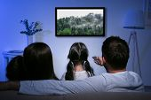 Family watching television at home. Leisure and entertainment concept. poster