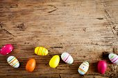 Colorful Easter eggs on wooden background poster