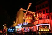 PARIS - OCT 29: The Moulin Rouge by night, on October 29, 2010 in Paris, France. Moulin Rouge is a f