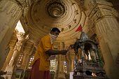stock photo of jainism  - jain priest praying temple of lodruva jaisalmer in rajasthan state in india - JPG