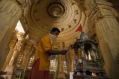 image of jain  - jain priest praying temple of lodruva jaisalmer in rajasthan state in india - JPG