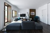 Modern loft living room interior with large comfortable modular lounge suite, hardwood floorboards a poster