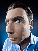 stock photo of voyeur  - caucasian man observe suspicious  portrait isolated studio on black background - JPG