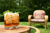 stock photo of iced-tea  - Two glasses of iced tea garnished with mint - JPG