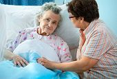 stock photo of geriatric  - Senior female is being visited by the daughter in hospital - JPG