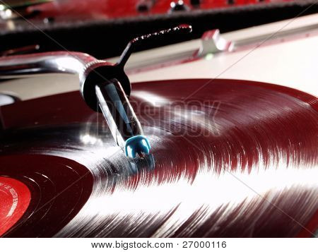 Record player spinning and vinyl disc .