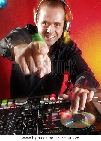 Disc jockey working at discotheque.