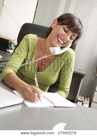 Optimist hispanic businesswoman working at office.