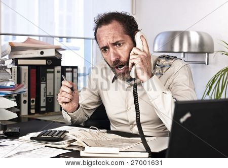 Furious Businessman On The Phone