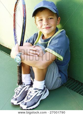 Ltttle kid tennis portrait.