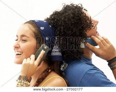 Young couple using a mobile phone. Young couple talking themselves by mobile phone.