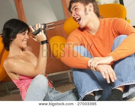 Young couple using a video camera. Young couple using a camcorder.