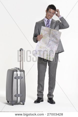 Traveler businessman holding a map.