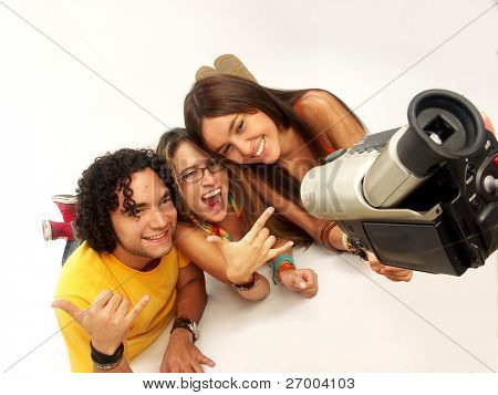 Young friends sharing and recording with a camcorder.