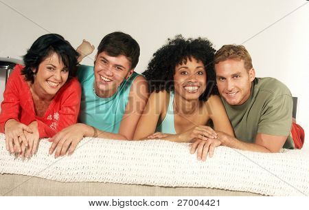 Young friends enjoying together in a living room.