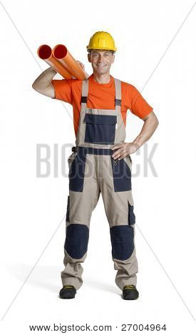 Plumber holding two plastic orange tubes. Construction worker holding two orange hydraulic tubes.