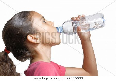 Little girl drinking mineral water bottle.