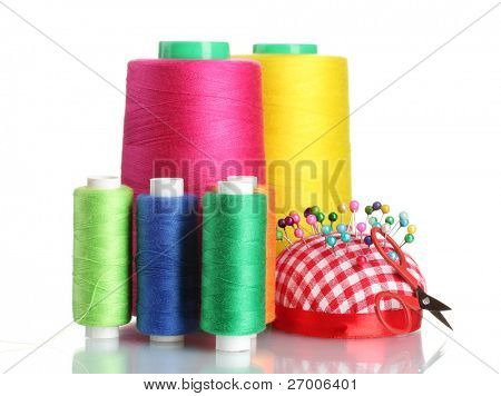 Bobbins of thread with colored pinheads in pin-cushion isolated on white