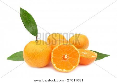 Clementines mandarin oranges with green leaves