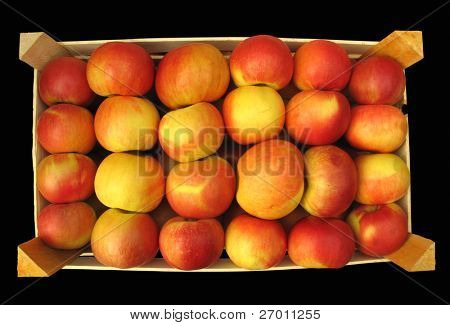apples in wooden crate on black