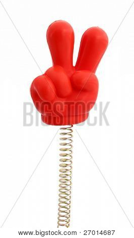 Hand red rubber on spring showing two fingers sign of victory