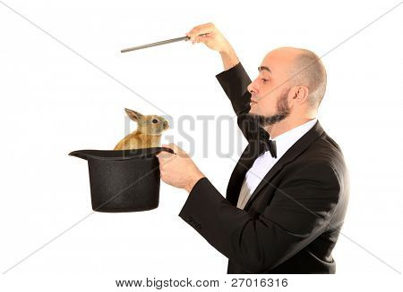 Illusionist magician with magic wand and top hat