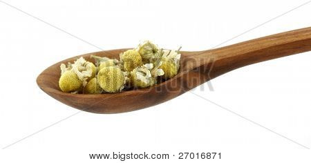 Chamomile dried in wooden spoon