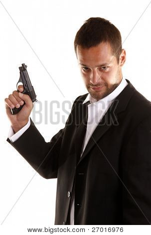 Handsome man with gun elegant spy