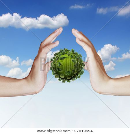 Hand holding green earth