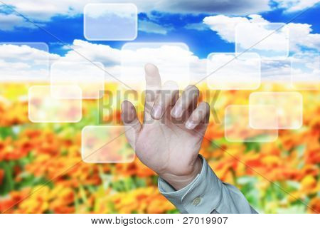 Beautiful hand pushing a button on a touch screen