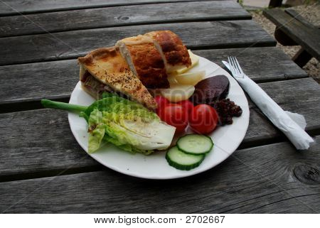Plate Of Traditional English Pub Food, Pie Adn Beets