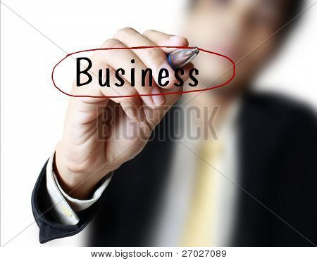 businessman drawing on glass