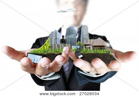 person holding a business, building on hand