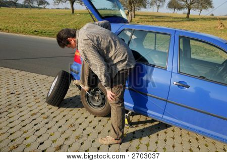 Changing A Tire On The Road