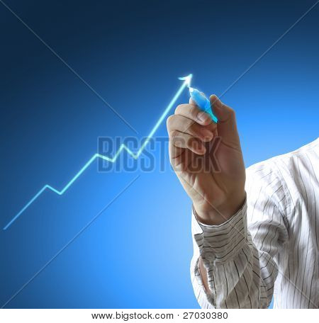 Male hand drawing a graph