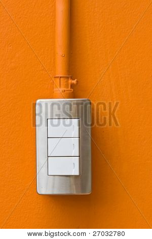 Light Switch on Orange Wall