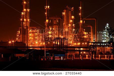 closeup of oil refinery factory pipeline at night