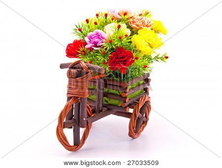 beautiful and colorful flower bouquet in wooden basket in car shape